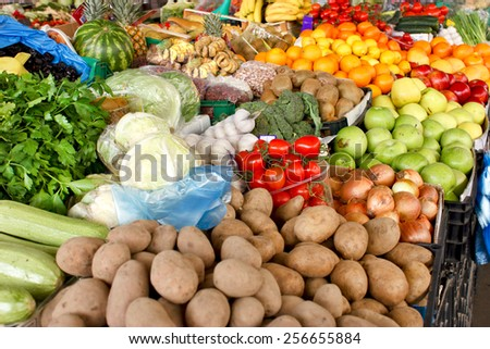 Fresh organic fruits and vegetables on farmers market - stock photo