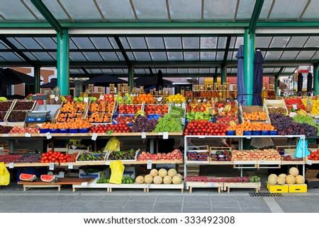 Fresh organic fruits at farmers market stall - stock photo