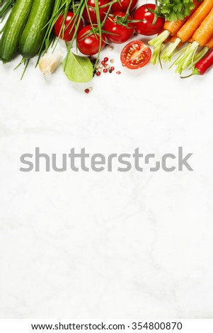 fresh organic garden vegetables on white rustic stone background, healthy cooking concept - stock photo