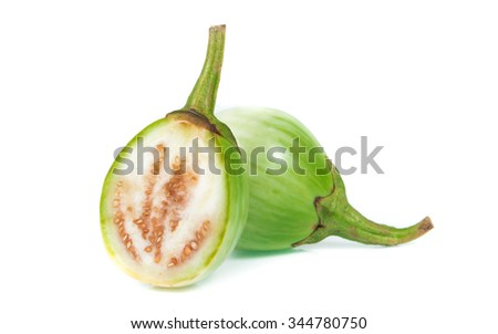 fresh organic green eggplant with drops of water on white