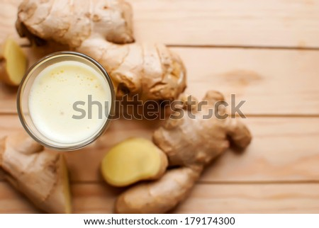 fresh organic healthy ginger shot juice and root - stock photo