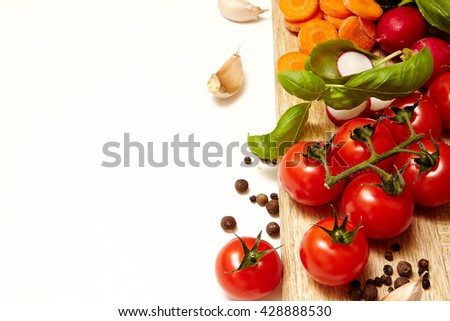 Fresh organic ingredients on white background with space for the text Cooking concept.