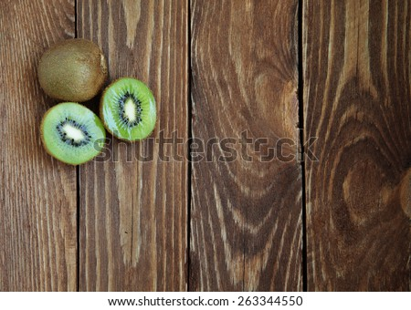 Fresh organic kiwis on a wooden table top view - stock photo