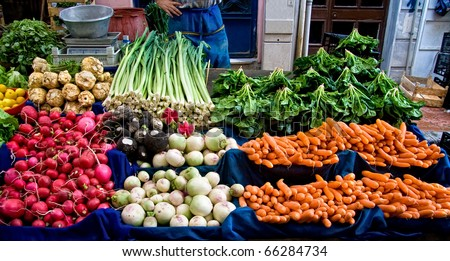 Fresh Organic Lemon, spinach, celery root, Lettuce, beet, radish, turnip, Mint, Carrot, and Leek At A Street Market In Istanbul, Turkey. - stock photo