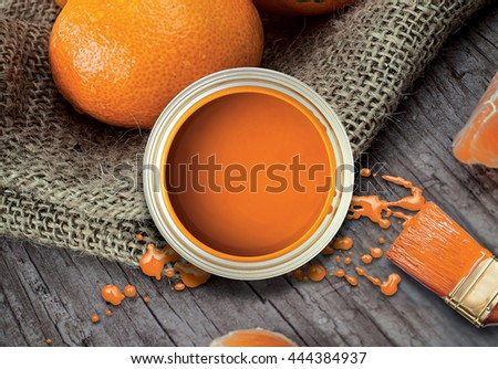 Fresh organic mandarin in a bowl. Rustic style. Orange paint, paint brush.