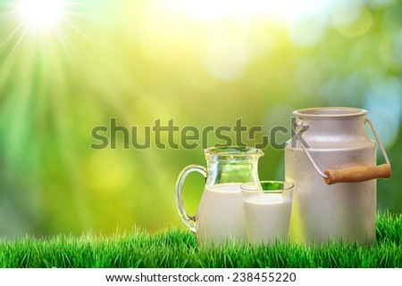 Fresh organic milk. Nature background. - stock photo