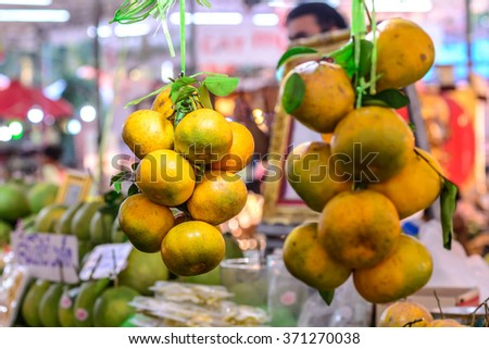 Fresh organic oranges are selling at supermarket.