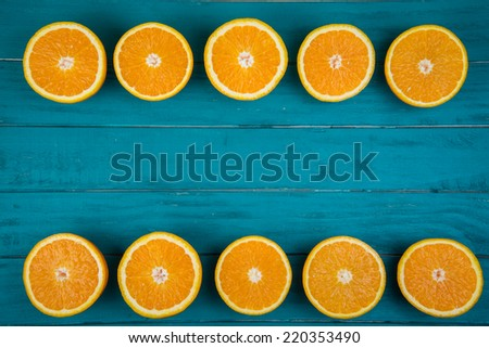 Fresh organic oranges fruits on blue wooden background with copy space - stock photo