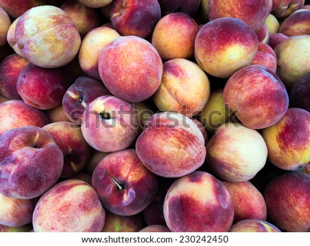 Fresh Organic Peaches Heap at the farmers Market on Union Square New York - stock photo