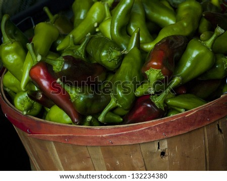 Fresh organic peppers at the local farmers market. Farmers markets are a traditional way of selling agricultural products. - stock photo