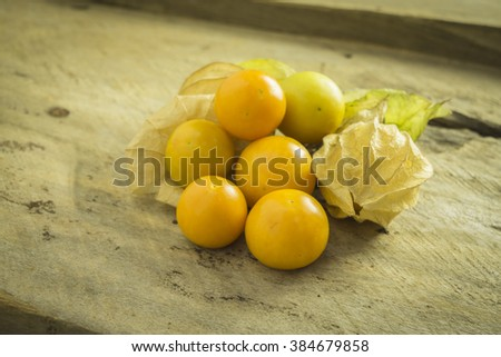 Fresh organic physalis fruit ,Helathy fresh Gooseberry Cape ,Uchuva delicious tropical fruit in Peru, Cape gooseberry (Physalis peruviana) plant on wooden background - stock photo
