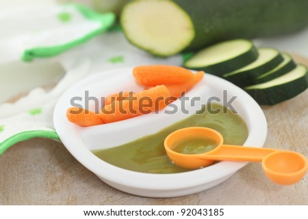 Fresh organic pureed vegetable food for baby - stock photo