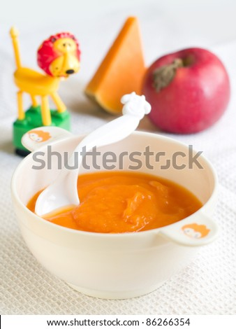 Fresh, organic pureed vegetables for baby. Shot for a story on homemade, organic, healthy baby foods. - stock photo