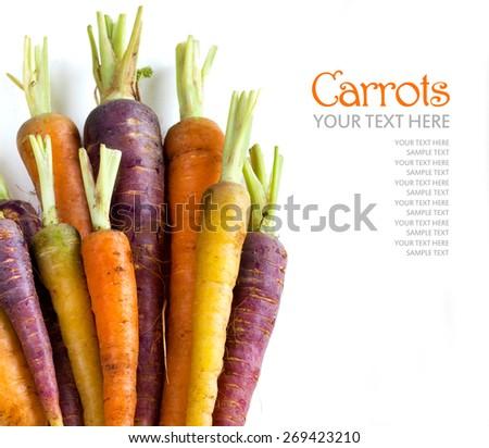 Fresh organic rainbow carrots  isolated on white - stock photo