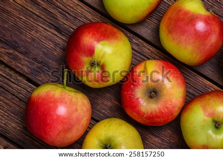 Fresh organic red apples on wooden table close-up