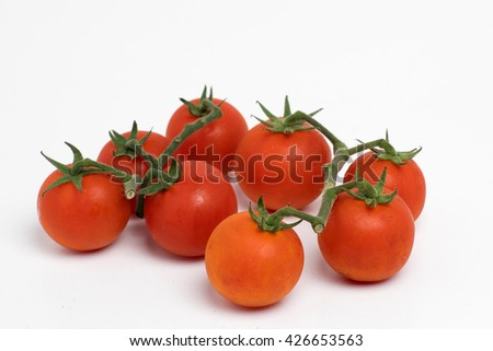 Fresh organic red tomatoes isolated on white background.
