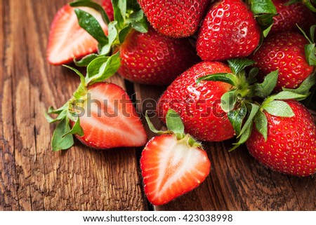 Fresh organic ripe strawberry on wooden table - stock photo