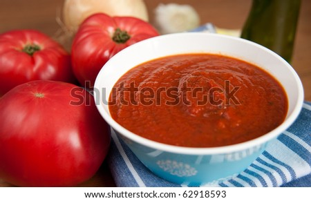Fresh Organic Tomato Sauce and Red Tomatoes - stock photo