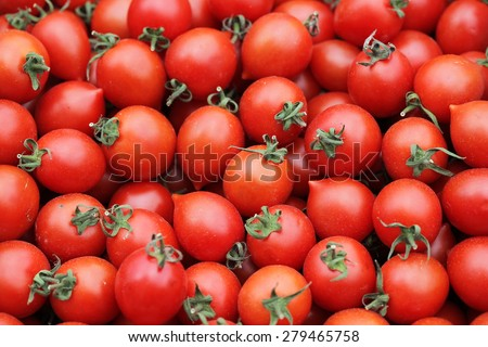 Fresh organic tomatoes background texture