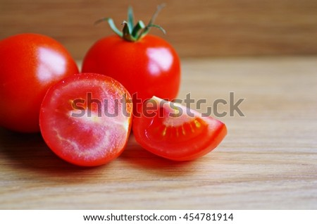 Fresh organic tomatoes  cherry on wooden background.