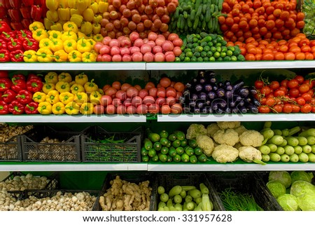 Fresh organic Vegetables and fruits on shelf in supermarket, farmers market. Healthy food concept. Vitamins and minerals. Tomatoes, paprika, capsicum, cucumbers, cabbage, mushrooms, zucchini, squash