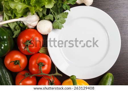 Fresh Organic Vegetables and Spices on a Wooden Background. - stock photo