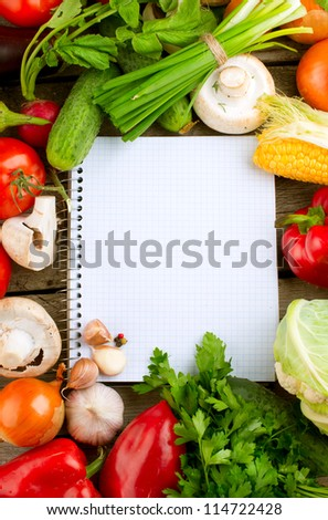 Fresh Organic Vegetables and Spices on a Wooden Background and Paper for Notes.Open Notebook and Fresh Vegetables Background.Diet.Dieting - stock photo