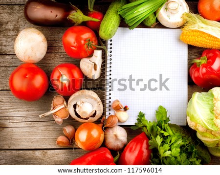 Fresh Organic Vegetables and Spices on a Wooden Background and Paper for Notes.Open Notebook. Diet. Dieting Concept - stock photo