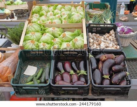 Fresh organic vegetables in crates at Farmers Market - stock photo