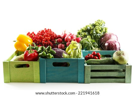 Fresh organic vegetables in wooden boxes, close up - stock photo