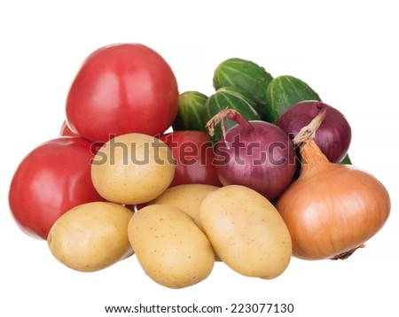 Fresh organic vegetables isolated on white background. Selective focus on potatoes and onions. - stock photo
