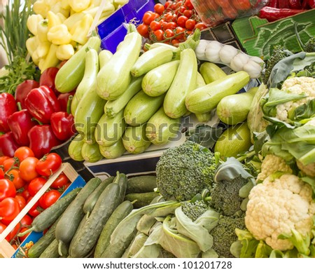 Fresh organic vegetables on market stalls - stock photo