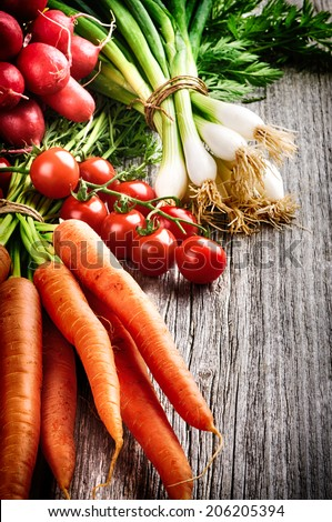 Fresh organic vegetables on old wooden table