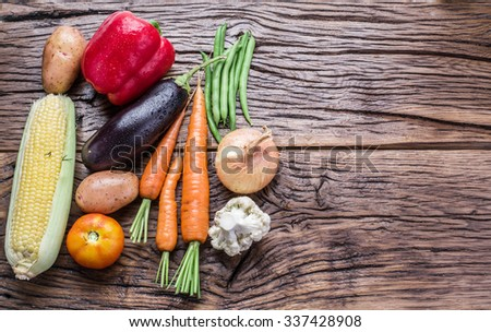 Fresh organic vegetables on the wooden table. Top view. - stock photo