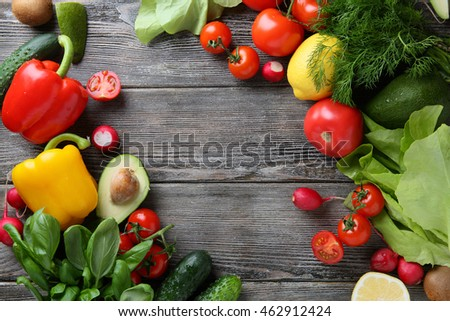 Fresh organic vegetables on wood boards. Healthy food background