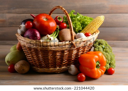 Fresh organic vegetables on wooden background - stock photo