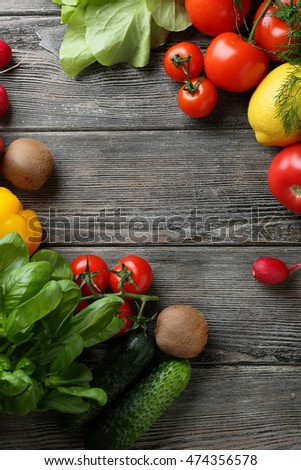 Fresh organic vegetables on wooden background, food above
