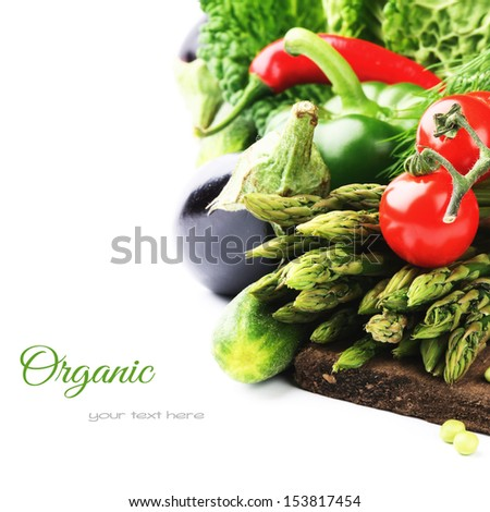 Fresh organic vegetables on wooden cutting board  - stock photo