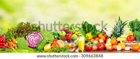 Fresh organic vegetables over green background. Healthy diet. - stock photo