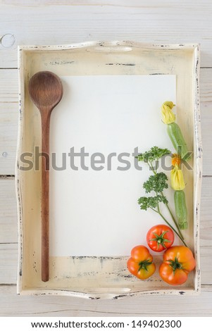 Fresh organic vegetables with paper for notes - stock photo