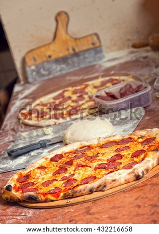 Fresh original Italian raw and ready to eat pizza, dough, preparation in traditional style.  - stock photo