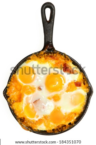 Fresh Oven Baked Eggs with Sausage and Cheddar Cheese over White - stock photo