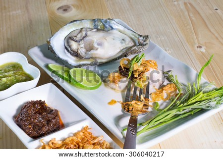 Fresh Oyster and flavoring in eating /Seafood/ Thai style