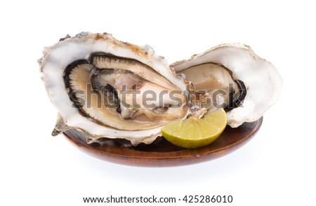 Fresh oyster with slice lemon on dish isolated on white background - stock photo