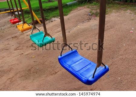 Fresh paint on the playground swings - stock photo