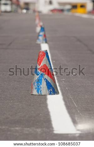 Fresh painted lines at road and traffic cone