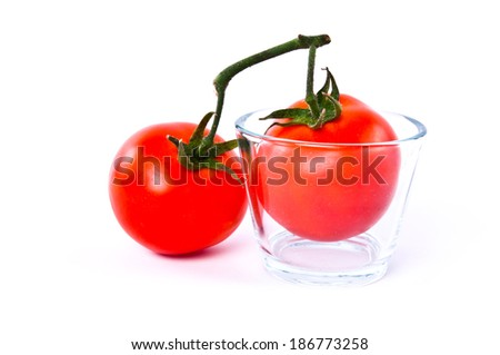 Fresh Pair two of Red Tomato with glasses cup isolated on white background.