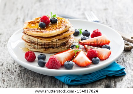 fresh pancakes with fruits - stock photo