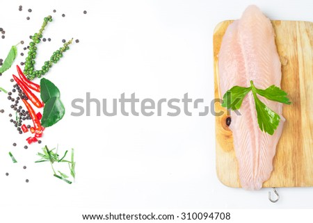 Fresh Pangasius dory or Basa Fish Fillet with ingredient Herb on white isolated - stock photo