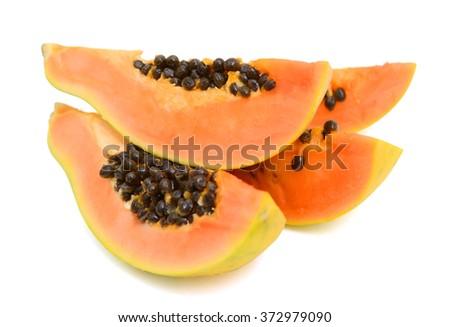 fresh papaya slices on white background  - stock photo